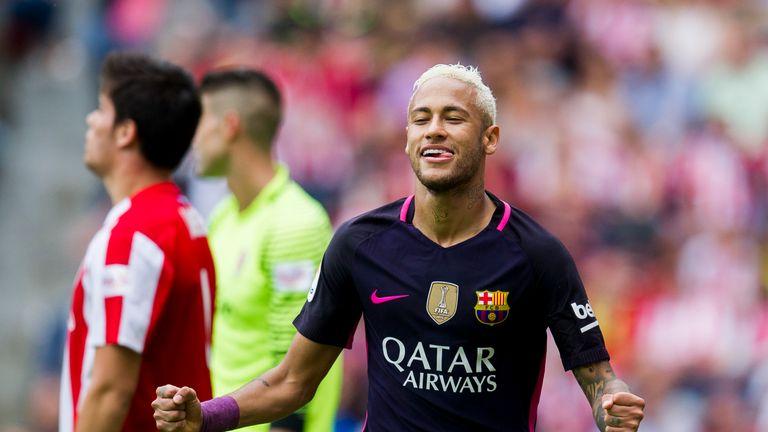 Neymar of FC Barcelona celebrates after scoring his team's third goal during the La Liga match between Real Sporting de Gijon