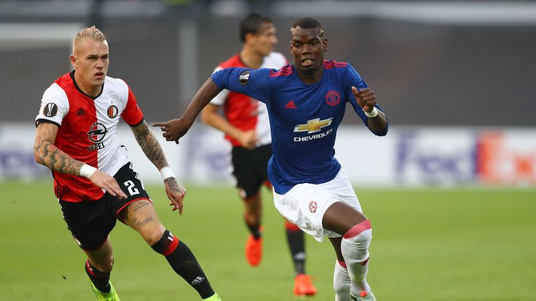 Rick Karsdorp of Feyenoord chases down Paul Pogba of Manchester United during the UEFA Europa League Group A match
