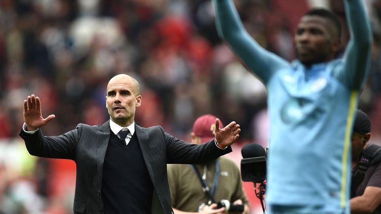 Pep Guardiola and his players celebrate a 2-1 victory at full-time in the Manchester derby