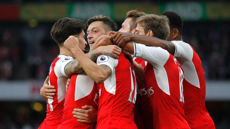 Arsenal's Mesut Ozil (C) celebrates scoring their third goal