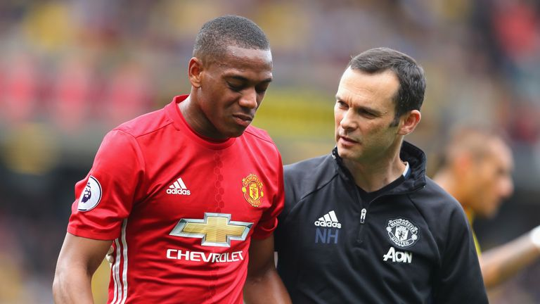 Anthony Martial is taken off the pitch by a member of the medial team