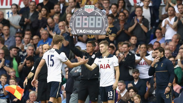 Ben Davies (R) comes on for Eric Dier