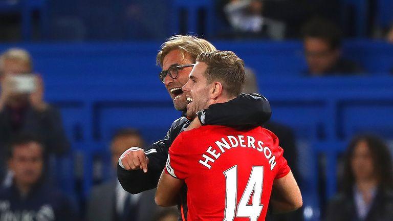 Jurgen Klopp and Jordan Henderson of Liverpool celebrate victory over Cheslea at Stamford Bridge