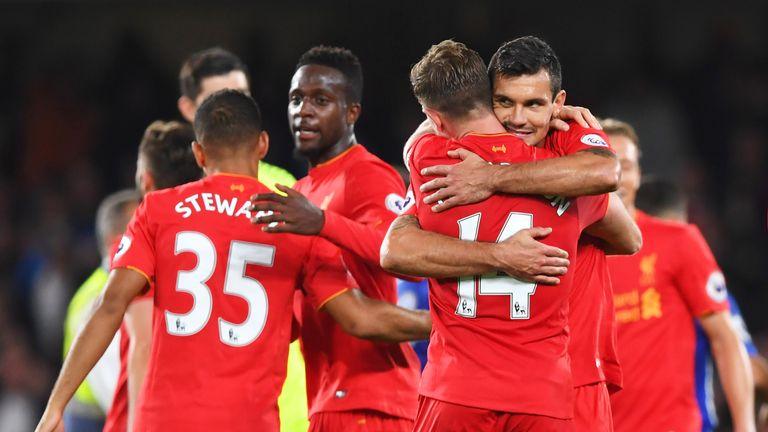 Goalscorers Jordan Henderson (14) and Dejan Lovren celebrate victory over Chelsea at Stamford Bridge