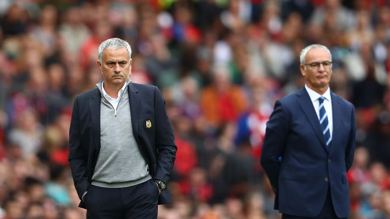 Jose Mourinho (L) and Claudio Ranieri look on at Old Trafford