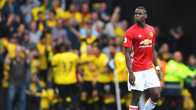 Paul Pogba looks on as Watford players celebrate at Vicarage Road