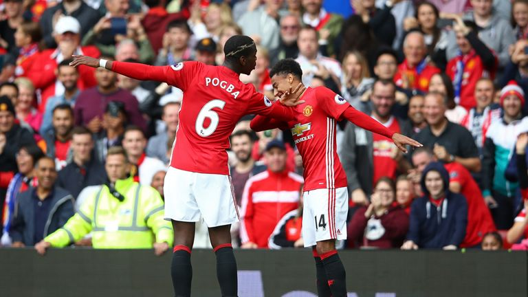 Paul Pogba (L) performs the Dab with Jesse Lingard after scoring for Manchester United