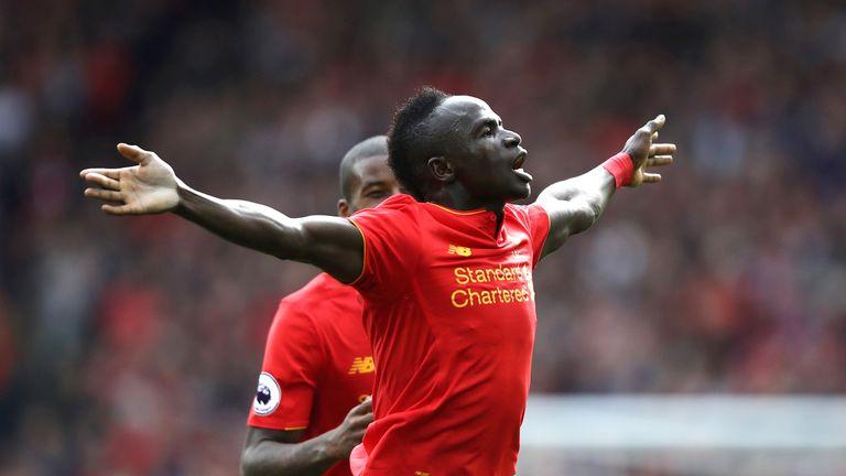 Sadio Mane celebrates scoring the third goal of the game for Liverpool