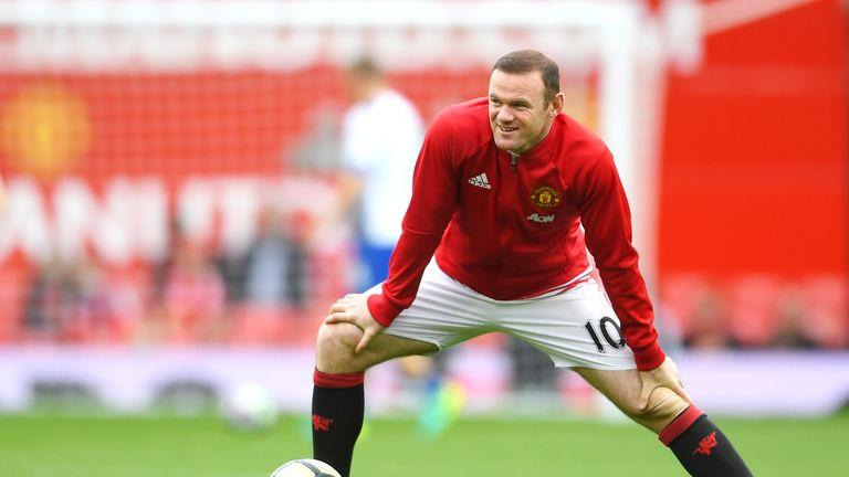 Wayne Rooney warms up prior to kick-off at Old Trafford