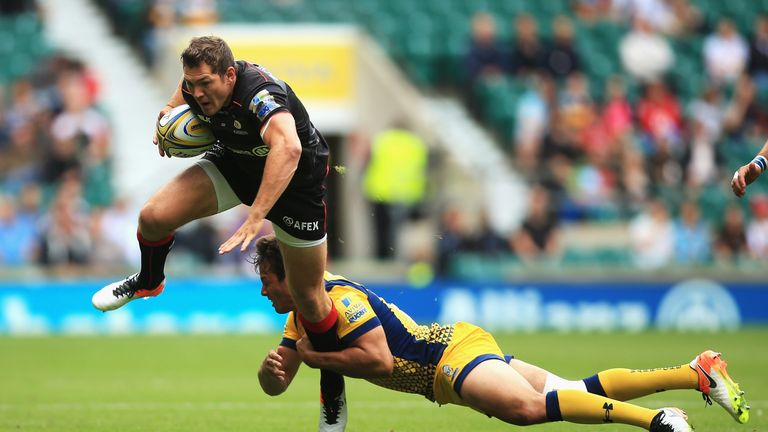 Alex Goode is tackled by Worcester's Dean Hammond