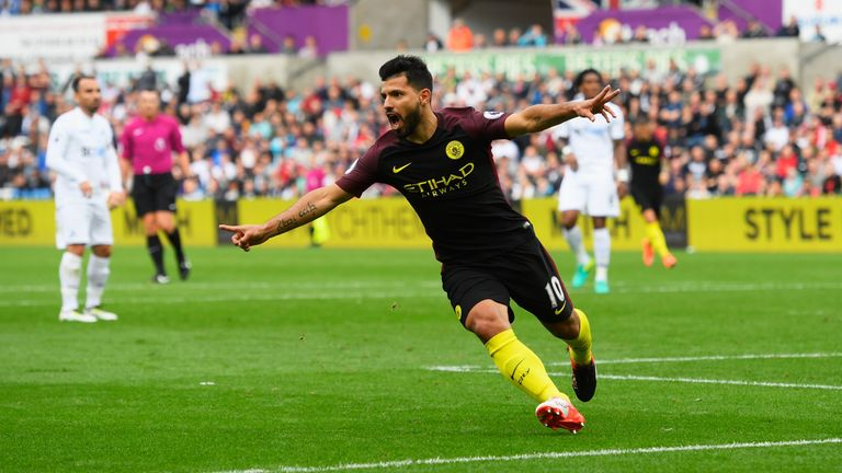 SWANSEA, WALES - SEPTEMBER 24: Sergio Aguero of Manchester City celebrates scoring his sides first goal  during the Premier League match between Swansea Ci