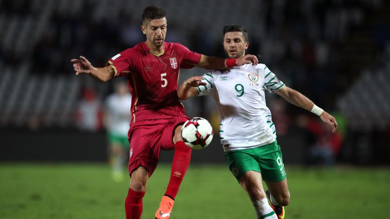 Republic of Ireland's Shane Long (right) and Serbia's Matija Nastasic battle for possession