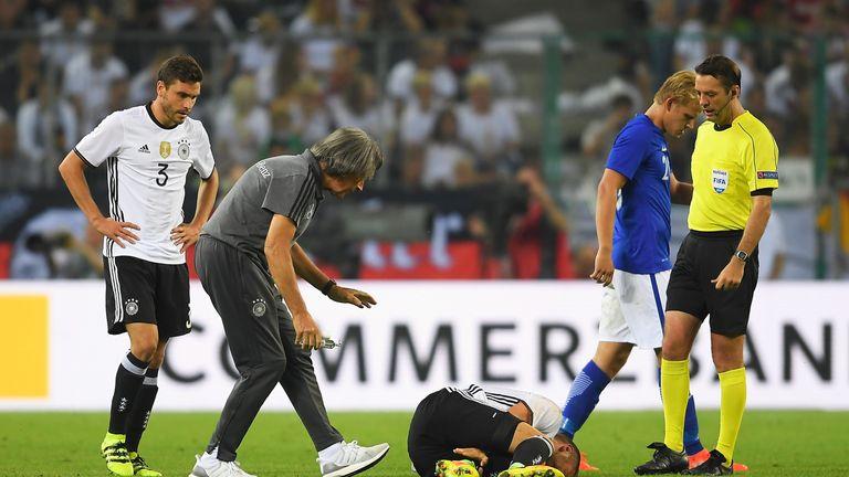 Germany's Shkodran Mustafi holds his leg earlier this week