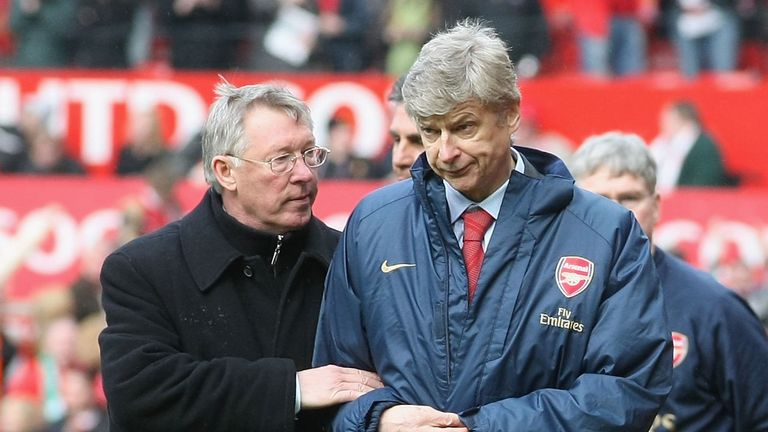 Sir Alex Ferguson of Manchester United and Arsene Wenger of Arsenal walk off