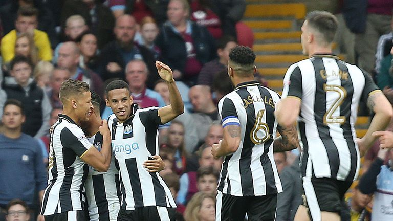 Newcastle United players celebrate after Aston Villa's Tommy Elphick (not pictured) scores an own goal