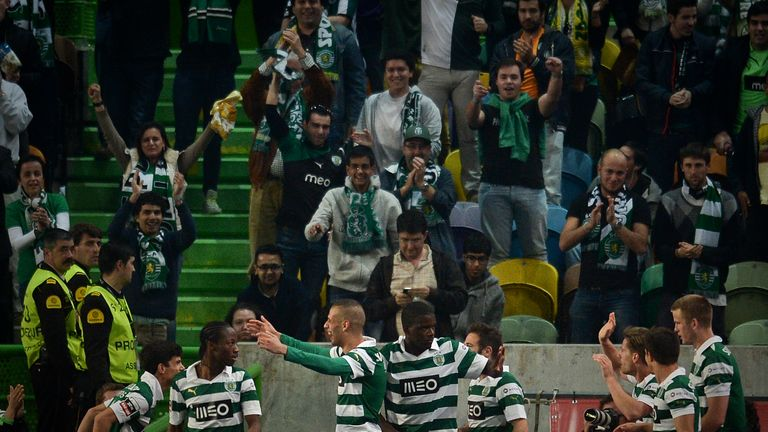 Sporting's Islam Slimani celebrates with his team-mates after scoring against FC Porto during the Portuguese league football match in March 2014