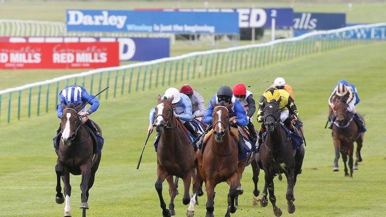 Talaayeb and Paul Mulrennan (black cap) come with a winning challenge down the centre to win the newmarketracourses.co.uk Maiden Fillies' Stakes.