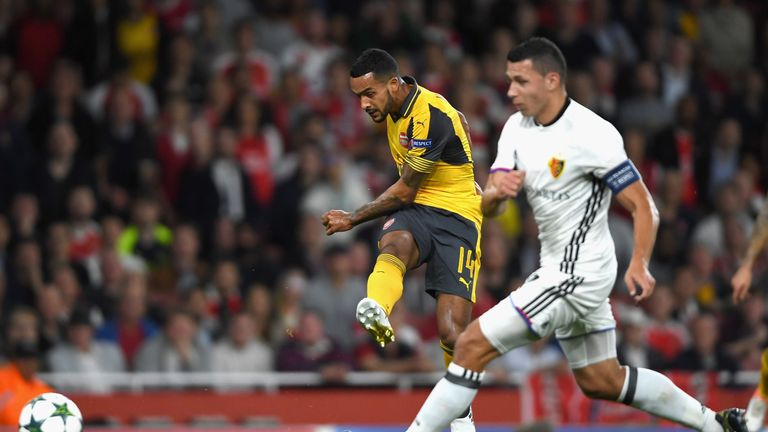Theo Walcott of Arsenal scores his team's second goal during the UEFA Champions League Group A match against Basel