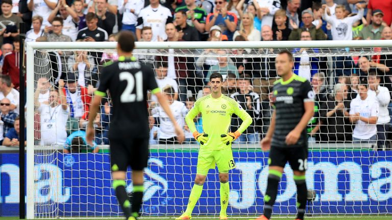 Chelsea goalkeeper Courtois (centre) appears dejected