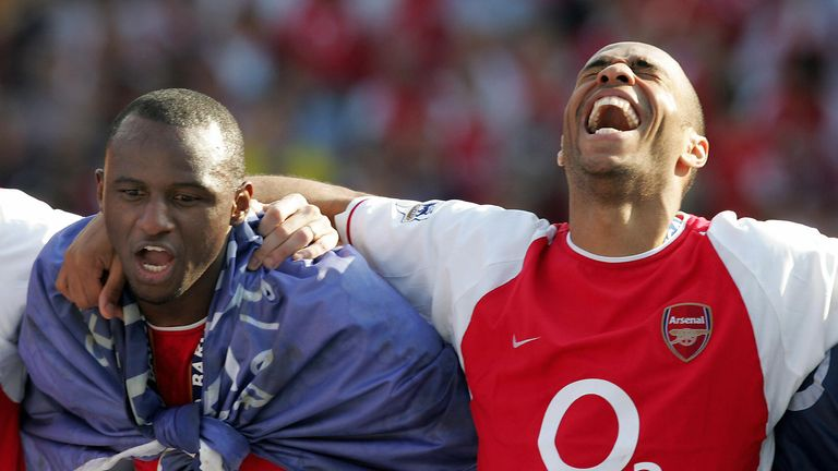 LONDON, UNITED KINGDOM:  Arsenal's Patrick Vieira (L) and Thierry Henry celebrate after winning the Premiership title and defeating Leicsester City 15 May,