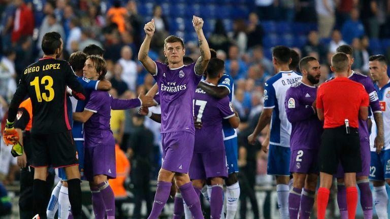 Real Madrid's German midfielder Toni Kroos (C) acknowledges the crowd
