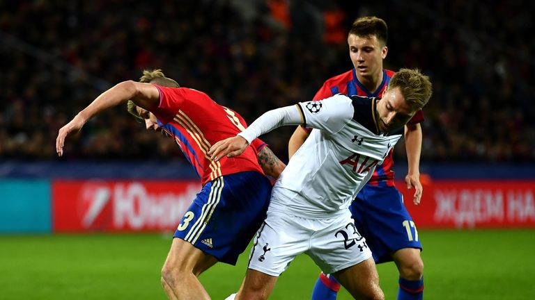 Christian Eriksen of Tottenham battles with Pontus Wernbloom and Aleksandr Golovin of CSKA Moscow