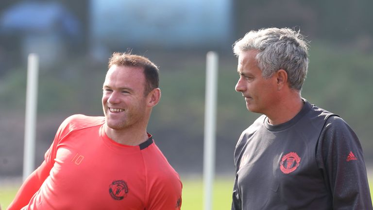 MANCHESTER, ENGLAND - SEPTEMBER 14:  Manchester United Manager Jose Mourinho and Wayne Rooney look on during a Manchester United training session at Aon Tr