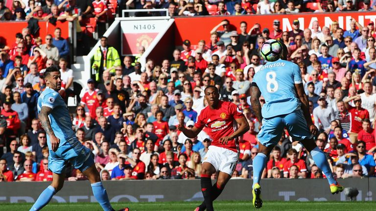 Anthony Martial of Manchester United scores his sides first goal during the Premier League match between Manchester Unite
