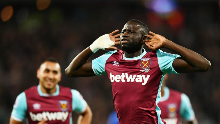 Cheikhou Kouyate of West Ham United celebrates scoring his side's first goal during the EFL Cup fourth round match v Chelsea