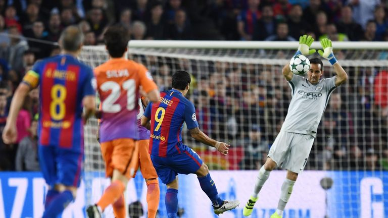 Claudio Bravo of Manchester City handles the shot from Luis Suarez of Barcelona outside of his area
