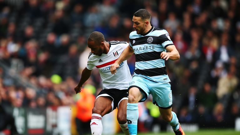 Conor Washington of QPR tackles with Denis Odoi of Fulham