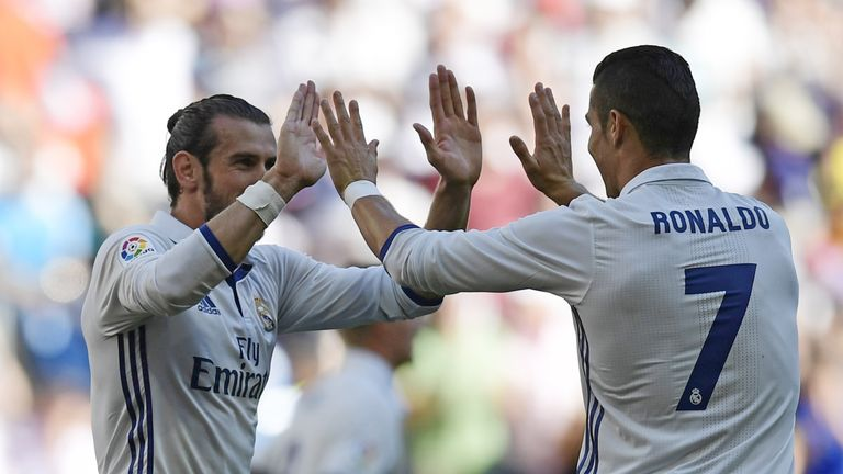 Real Madrid's Welsh forward Gareth Bale (L) and Real Madrid's Portuguese forward Cristiano Ronaldo celebrate after scoring a goal during the Spanish league