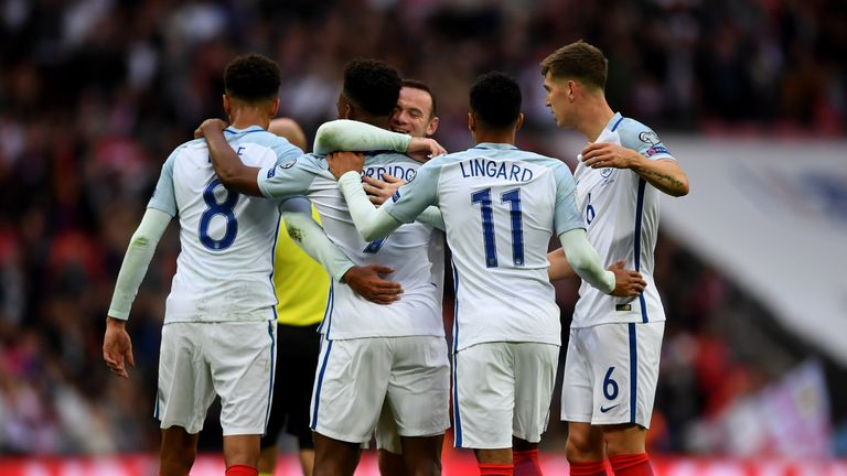 Daniel Sturridge celebrates with team mates after scoring the opening goal of the game