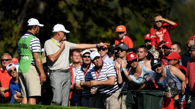 European vice-captain Ian Poulter looks to have a spectator removed on Saturday