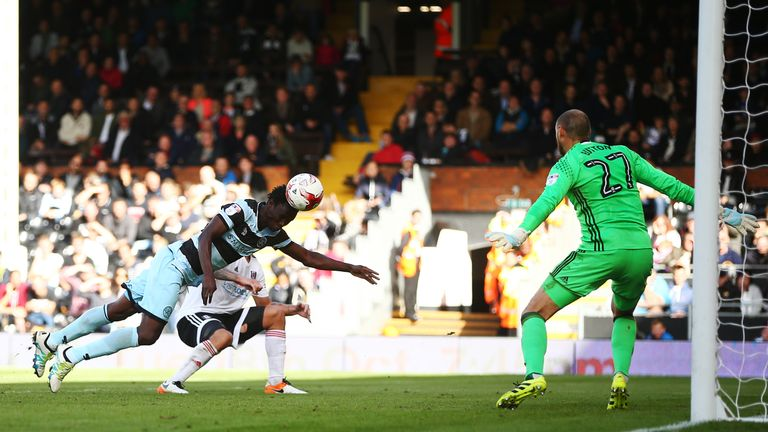 Idrissa Sylla leaps to head the winner at Craven Cottage
