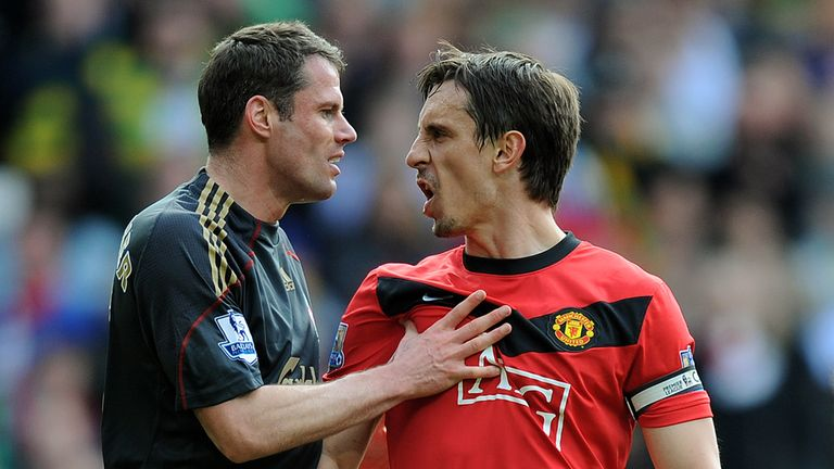 Jamie Carragher (L) of Liverpool argues with Gary Neville of Manchester United after United were awarded a first-half penalty, March 2010, Premier League