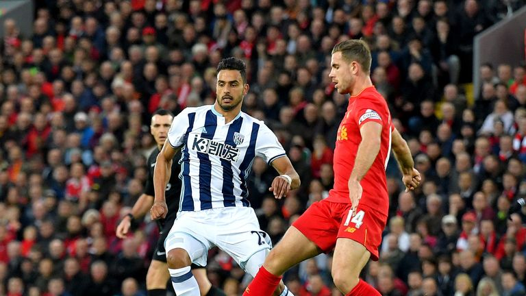 Jordan Henderson (right) challenges for the ball with West Brom midfielder Nacer Chadli