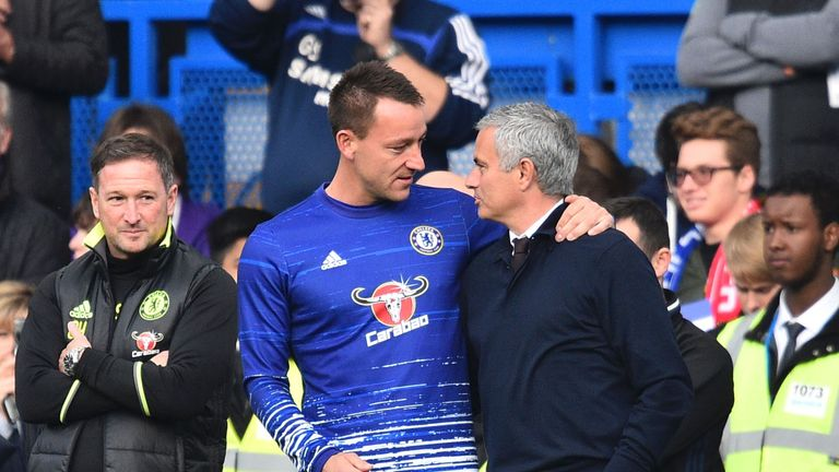 Manchester United manager Jose Mourinho speaks to John Terry