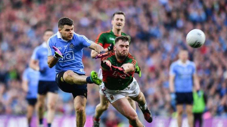 Dublin's Kevin McManamon and Mayo's Aidan O'Shea fight for the ball in the All-Ireland final replay at Croke Park