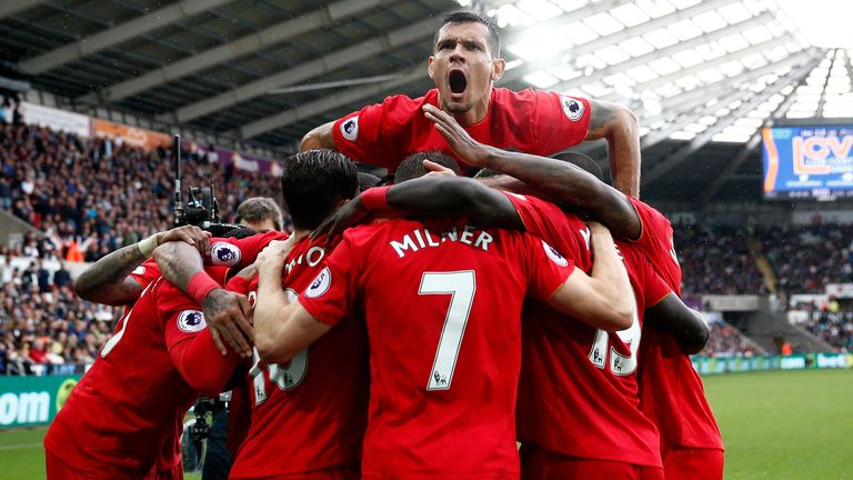 Liverpool celebrate Milner's winning penalty at Swansea