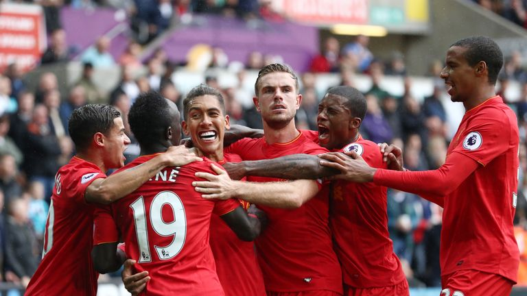 Liverpool's players celebrate Roberto Firmino's equaliser against Swansea