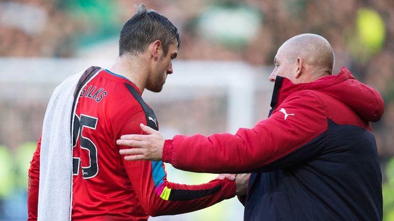 Mark Warburton shakes hands with goalkeeper Matt Gilks at full-time