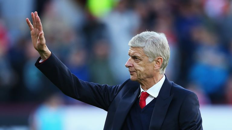 Arsene Wenger waves to fans prior to kick-off at Turf Moor
