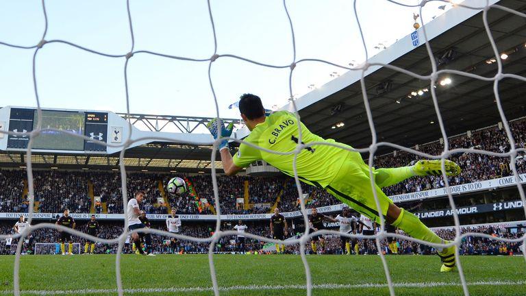 Claudio Bravo saves Erik Lamela' s penalty during the match at White Hart Lane
