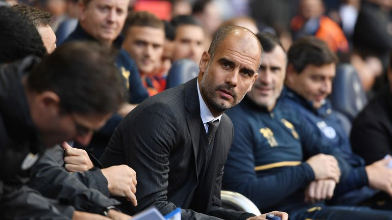 Pep Guardiola takes his seat on the away team bench prior to kick-off