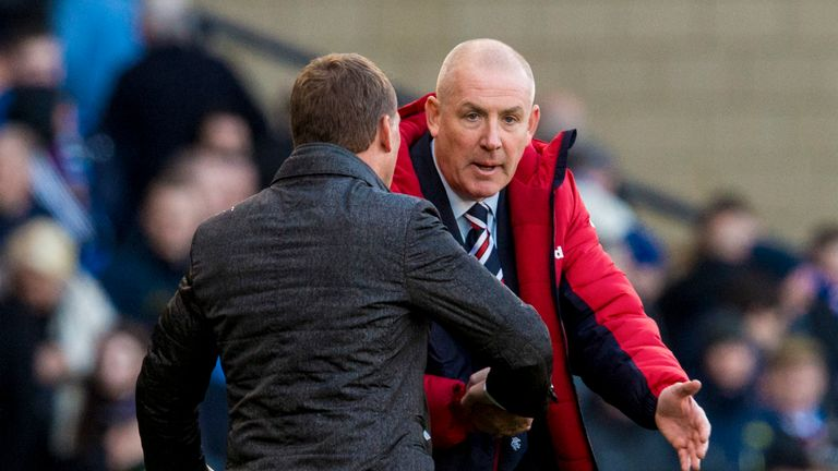 Rangers manager Mark Warburton shakes hands with Brendan Rodgers at full-time