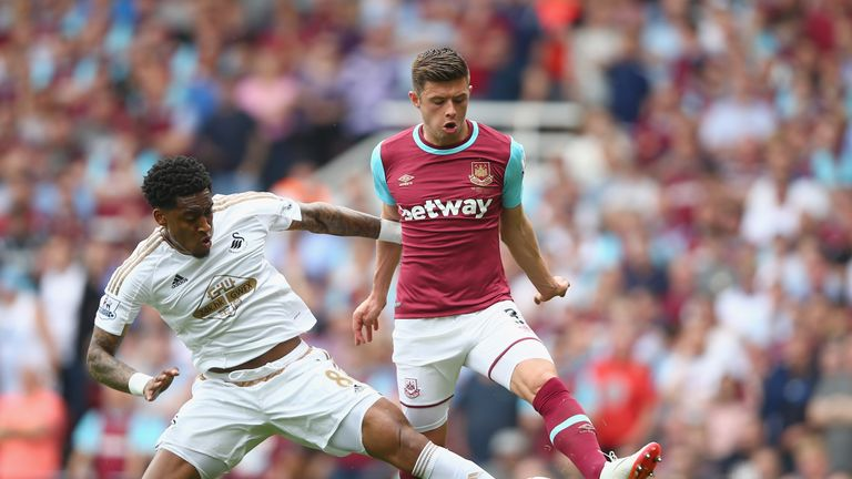 LONDON, ENGLAND - MAY 07:  Leroy Fer of Swansea City tackles Aaron Cresswell of West Ham United during the Barclays Premier League match between West Ham U