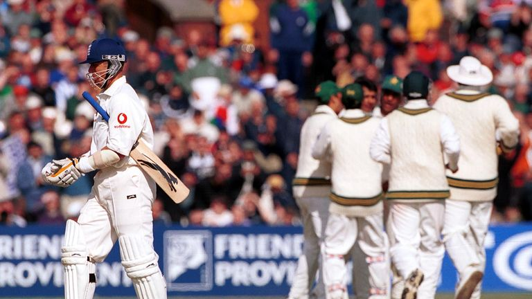 Alec Stewart walks off the field as England collapse to defeat against Pakistan at Old Trafford in 2001