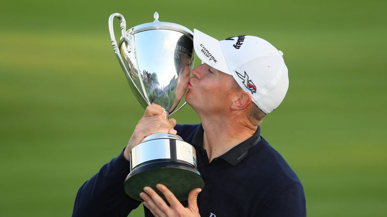 Alex Noren kisses the trophy following his victory at The Grove in 2016