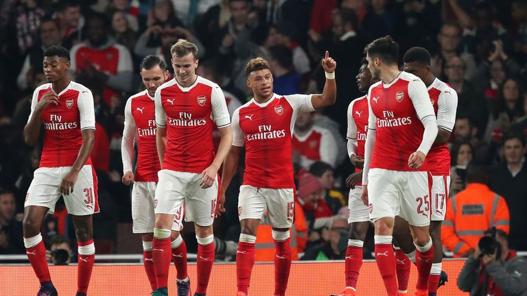 Alex Oxlade-Chamberlain celebrates with his team-mates after scoring Arsenal's first goal